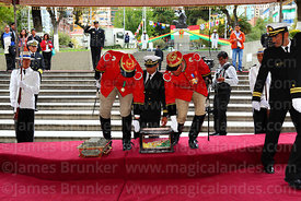 Members of the Los Colorados presidential guard place the Bolivian flag that was flown at the Battle of Alto Alianza next to the remains of Eduardo Abaroa, Plaza Avaroa, La Paz, Bolivia