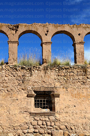 Arches and window of ruined section of Casa de la Inquisición, Plaza de Armas, Juli, Puno Region, Peru