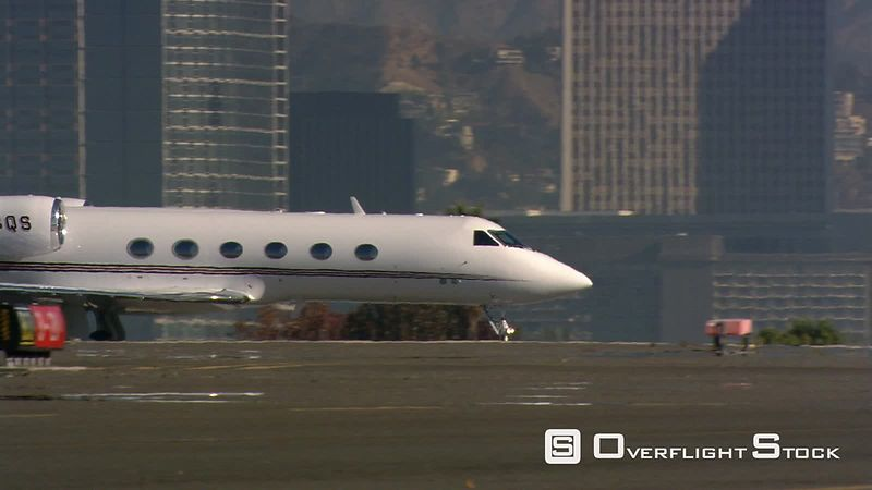 Close-up of executive jet taxiing toward take-off