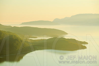 Midnight sun on fjord and mountains