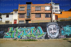 Portrait of old man on wall of residential suburb, La Paz, Bolivia