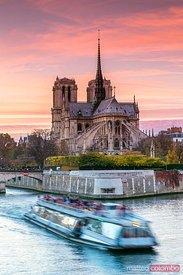 River Seine and Notre Dame at sunset with bateau mouche, Paris