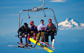Skiers and snowboarders on high-speed quad; Oregon Cascades, U.S.A.