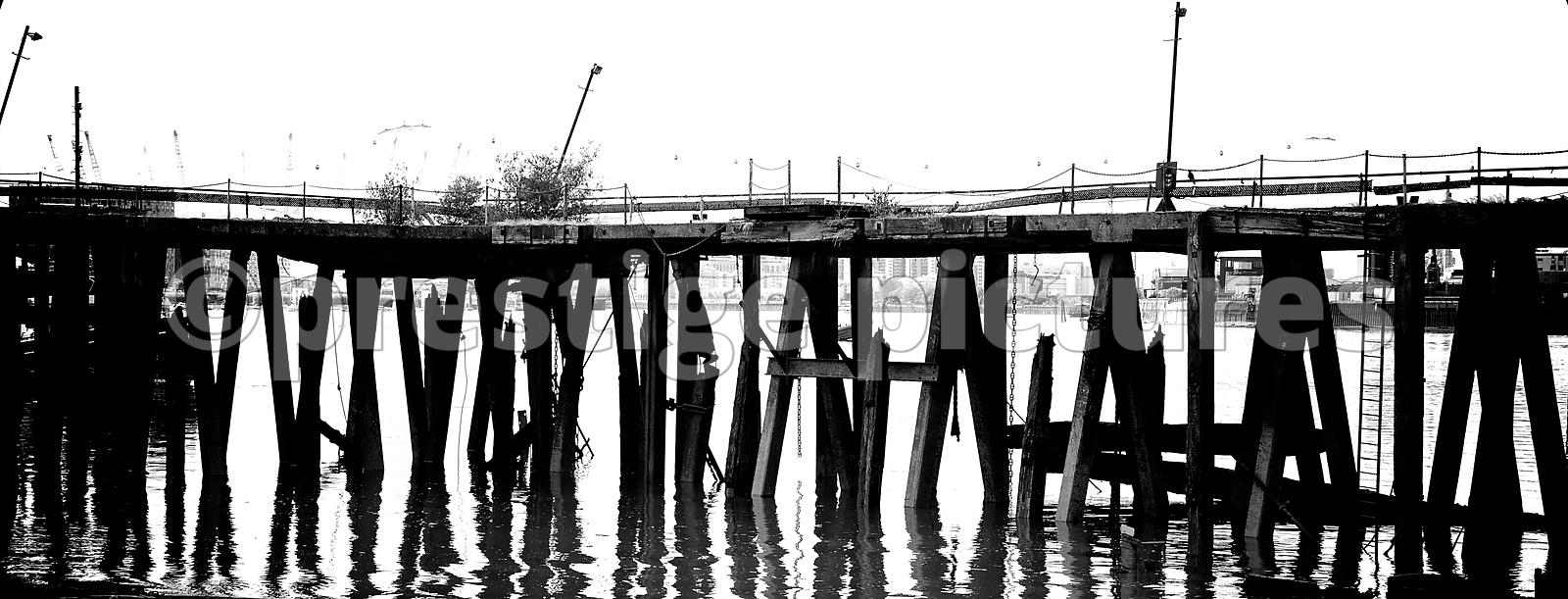 Legs of a Landing Stage and Reflections in the water of the River Thames