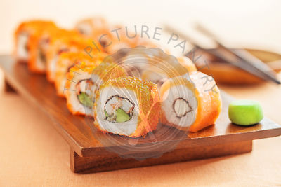 California and Alaska rolls on a wooden plate
