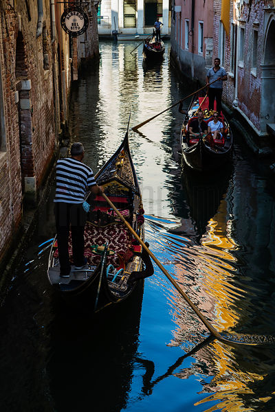 Three Gondolas on a Canal in Venice