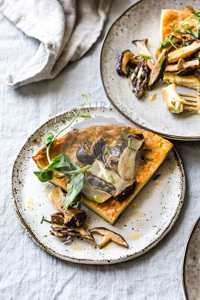 Wild Mushroom Savory Dutch Baby pancake with Pea Greens