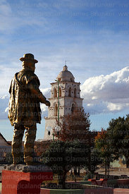 "Statue in village square and belfry of the so called ""Sistine Chapel of the Andes"" / Capilla Sixtina de los Andes, Curahuara de Carangas, Oruro Department, Bolivia"