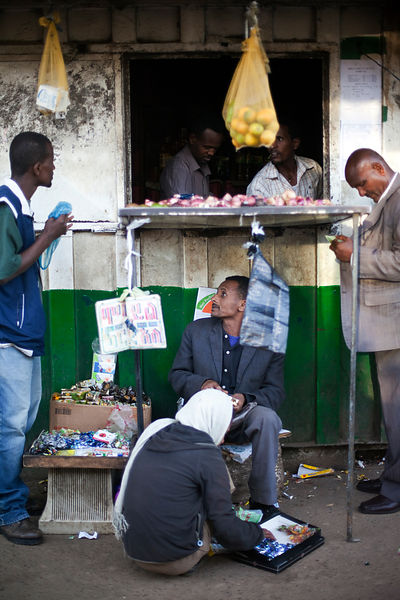 Ethiopia - Addis Ababa - Men at a roadside shop