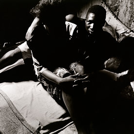 'Foday', a former child combatant with a prostitute in a brothel where he is the enforcer. The girl was abducted from her village and used as a concubine by RUF rebels. Freetown, Sierra Leone