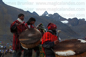 Young indigenous musicians on mountainside during Qoyllur Riti festival, Peru .