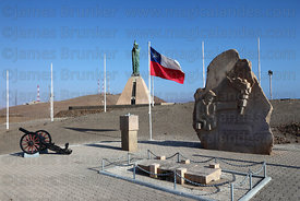 Monument to Unknown Soldier and Chilean flag on El Morro headland , Arica , Region XV , Chile