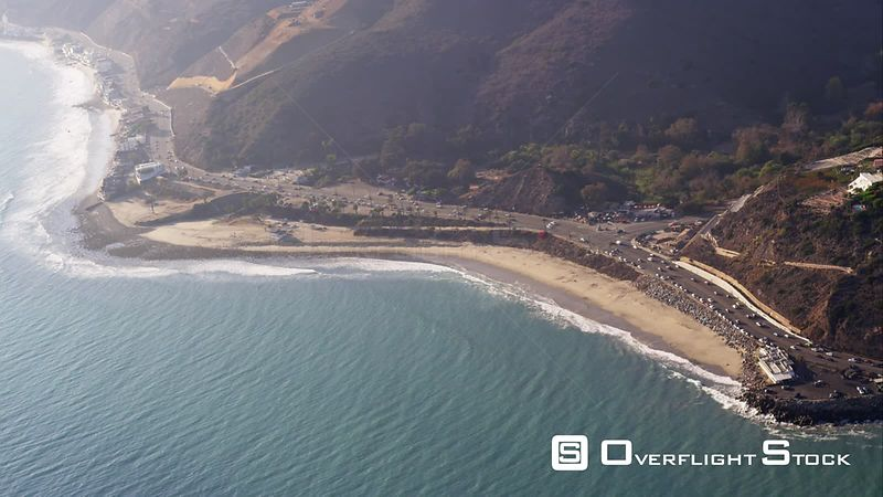 HA Aerial View Of Pacific Coast Highway And Beach Houses In Malibu, From The Topanga Canyon Road Intersection Westward, RED R3D 4k California
