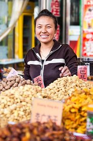 Woman at local street market in DUnhuang, China