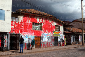 Building covered in graffiti protesting against unlicenced bars and discos in neighbourhood, Cusco, Peru