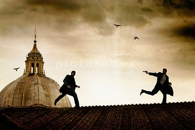 An atmospheric image of two mystery men in a rooftop chase in Rome, Italy.