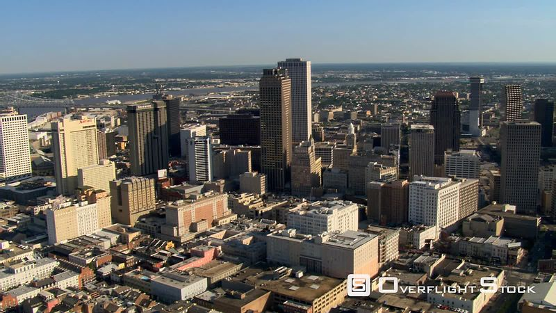 Flying over downtown New Orleans to orbit riverfront.
