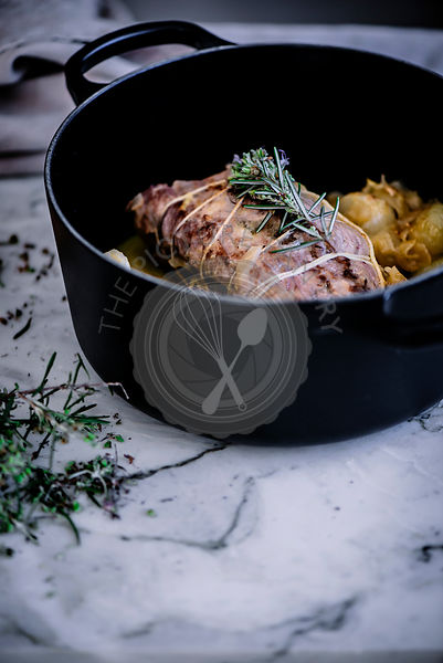 Iberian traditional roast pork, cooked with stuffed cheese and quince.