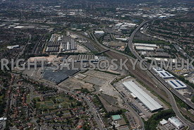Birmingham high level wide angle aerial photograph of the M6 motorway running west and railway stock yard with old railway engineering works and old industrialisation and dereliction