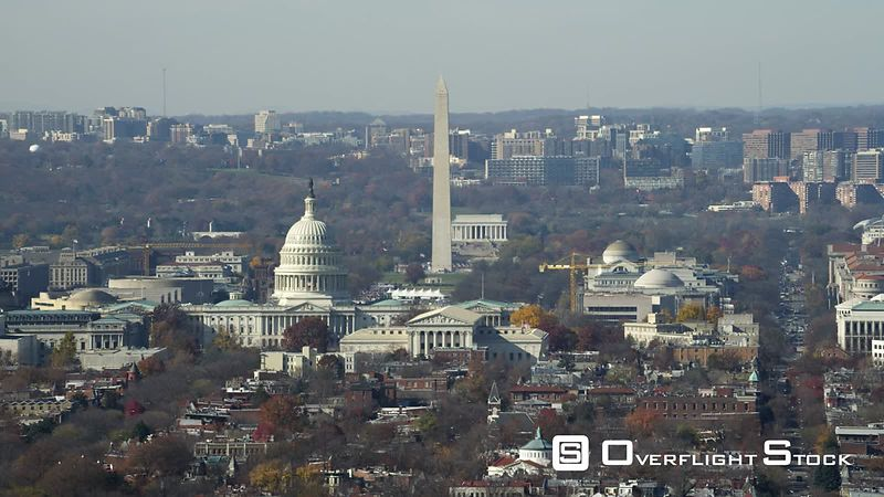 Over Capitol Hill, looking toward National Mall with Capitol rotunda, Washington Monument, and Lincoln Memorial in view. Shot in November