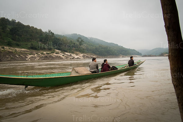People travelling in boat on Mekong River in Luang Prabang
