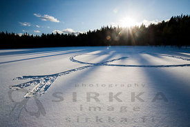 Snoeshoer' heart on ice of Haukilampi pond