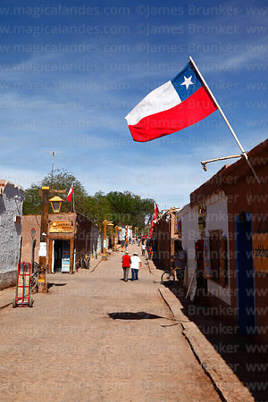Chilean flag and tourists in Caracoles street, San Pedro de Atacama, Region II, Chile