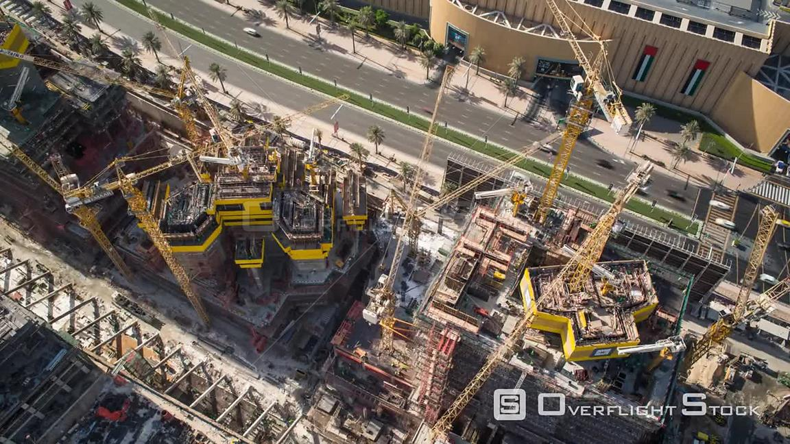 Timelapse looking down onto cranes moving on a construction site, Dubai, United Arab Emirates, January 2017.