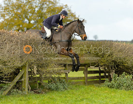 Louise Bevin jumping a fence near Gartree Covert