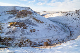 Peter's Stone, snow, in Cressbrook Dale