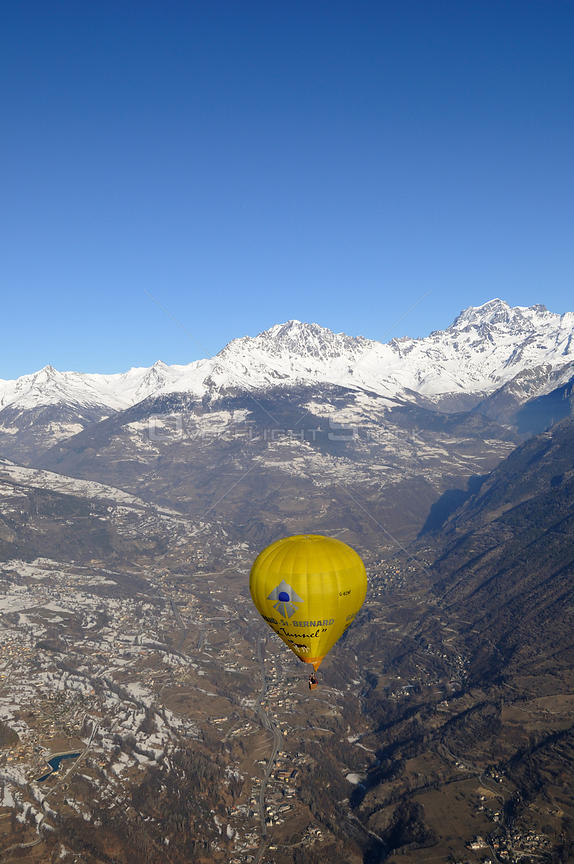 Hot air balloon in flight over the Aosta Valley, northern Italian Alps
