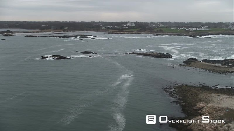 Flying Over Surf Toward a House on a Narrow Peninsula at Newport, Rhode Island. Shot in November