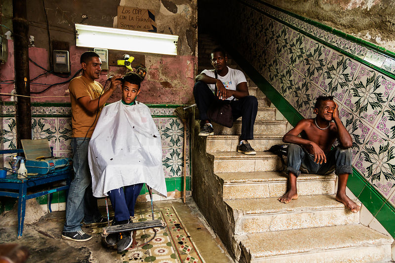 Young Boy Having a Haircut Inside a Barber's Shop