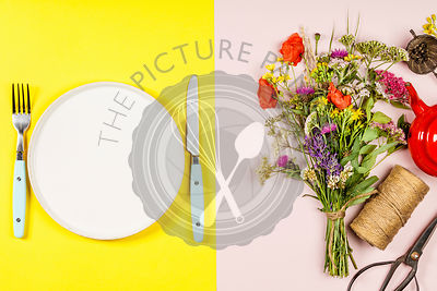 Flat lay of Wild flower bouquet and white plate on pastel color background