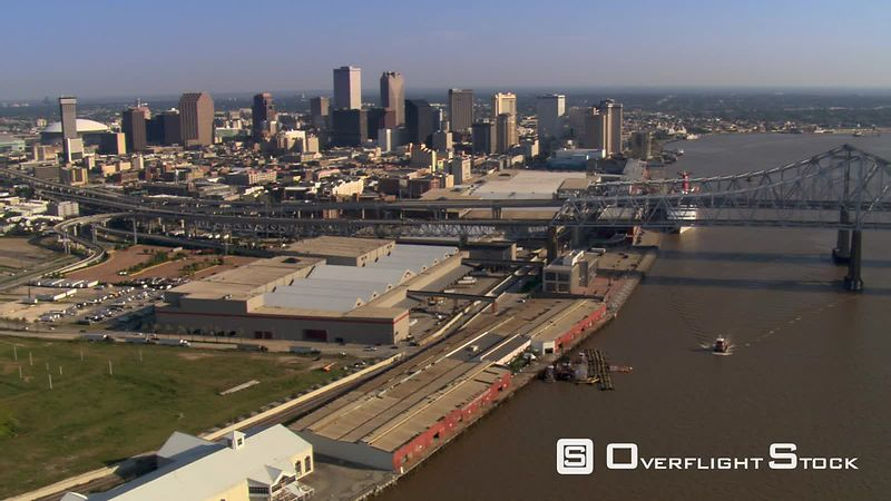 Flight looking back at downtown New Orleans and bridge.