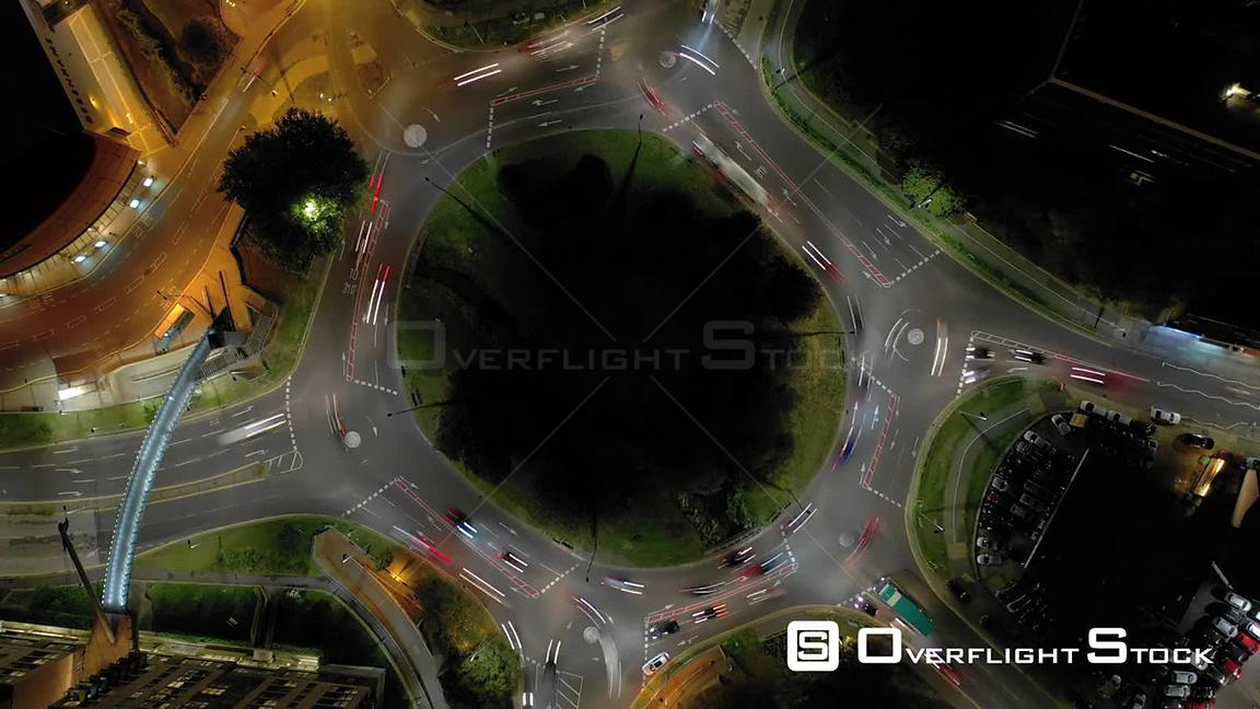 Night Time Lapse of a Busy Right Hand Traffic Circle.
