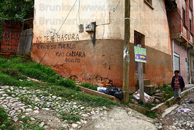 Rubbish dumped next to grafitti ordering people not to drop litter , Coroico , Bolivia