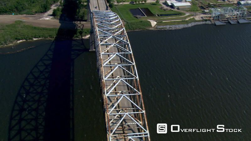 Flight over bridge and boats on a New Orleans canal