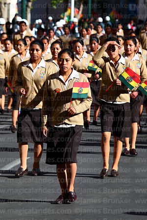 Schoolgirls carrying Bolivian flags during Independence Day parades, La Paz, Bolivia