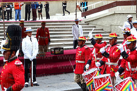 Members of the Los Colorados presidential guard parade past the remains of Eduardo Abaroa, Plaza Avaroa, La Paz, Bolivia