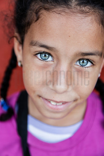 Portrait of a Young Girl with Very Blue Eyes