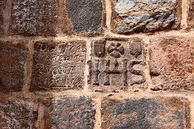 Christogram carving on wall of San Blas church, Cusco, Peru
