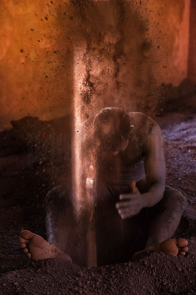 Portrait of a Kushti Wrestler Applying Mud to His Body During Practice