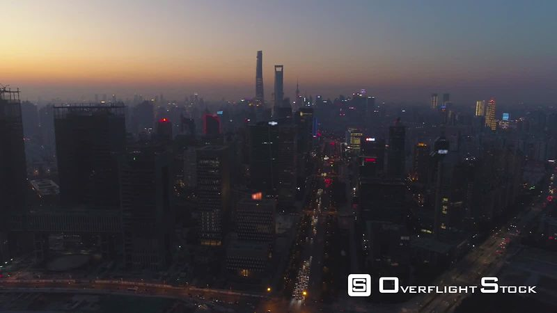Shanghai Skyline at Sunset. Lujiazui District and Century Avenue. Aerial View. Drone is Flying Sideways and Upward. Establishing Shot.