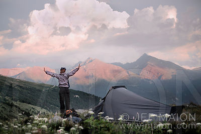 Backpacker and tent in beautiful mountain landscape