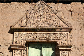 Detail of Christogram and ornate carved stone doorway of Casa de la Inquisición, Plaza de Armas, Juli, Puno Region, Peru
