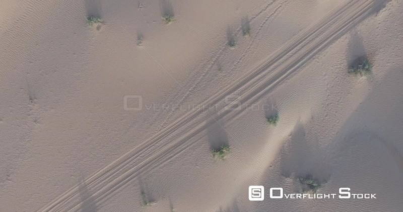 Drone Video of Car Tracks in Sand Dunes Dubai