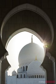 Sun over the dome of Sheikh Zayed Grand Mosque, Abu Dhabi