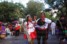 Couple in traditional dress dancing at carnival parade, Tarija, Bolivia