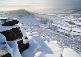 Snowy Curbar rocks to Baslow Edge